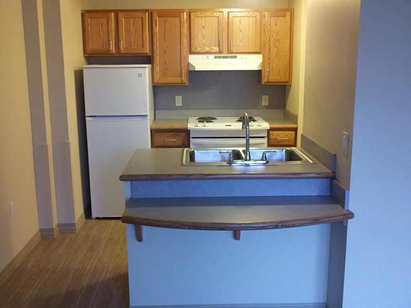 Margaret Wagner Apartments kitchen with counter-top seating