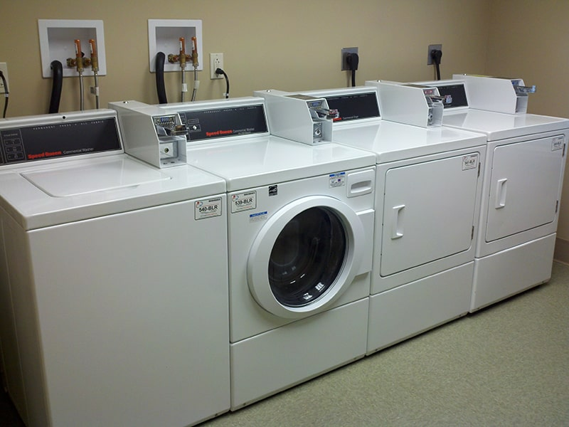 Margaret Wagner Apartments washers and dryers in laundry room