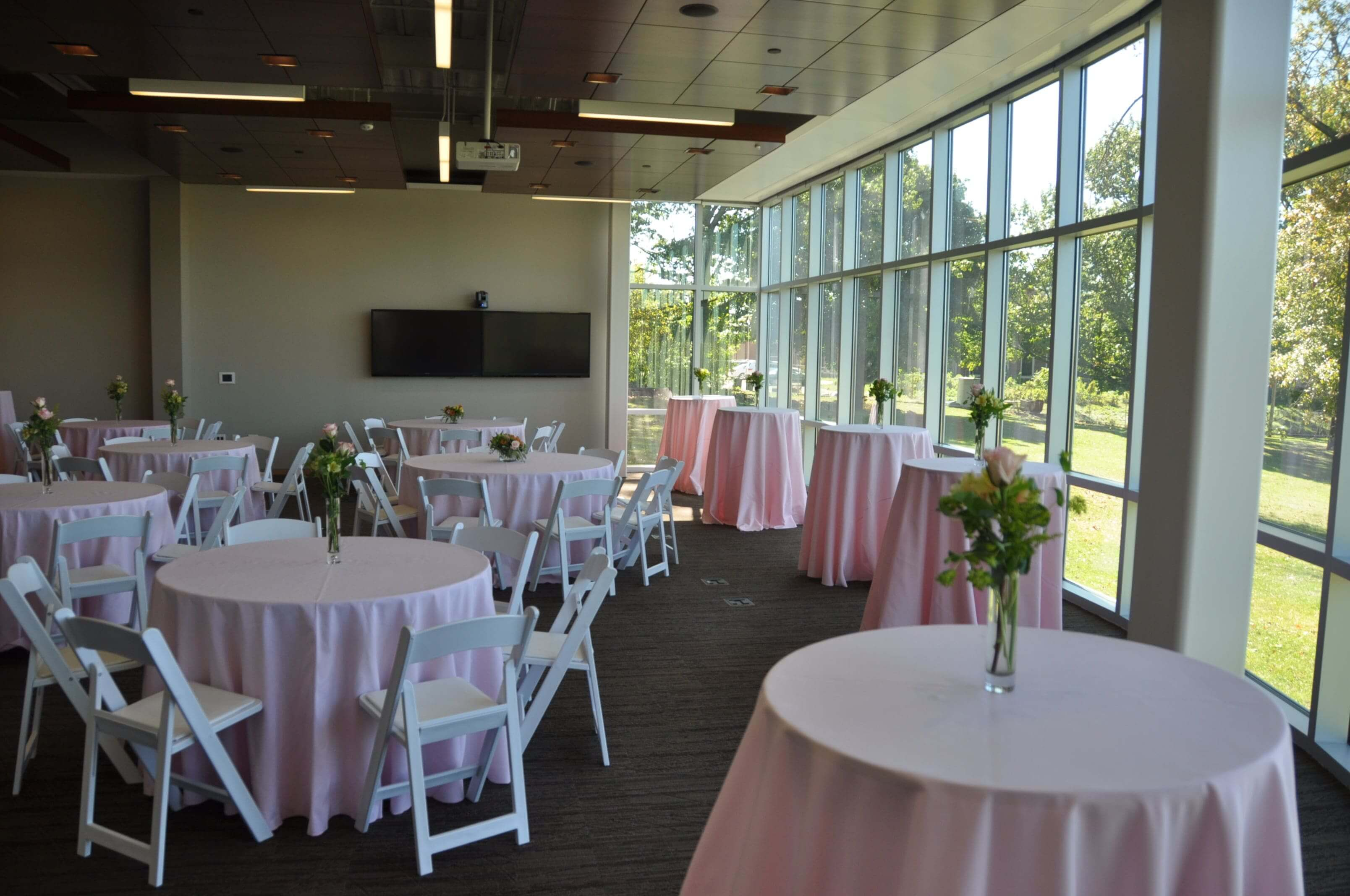 Conference Center at Benjamin Rose set up with small round tables with chairs