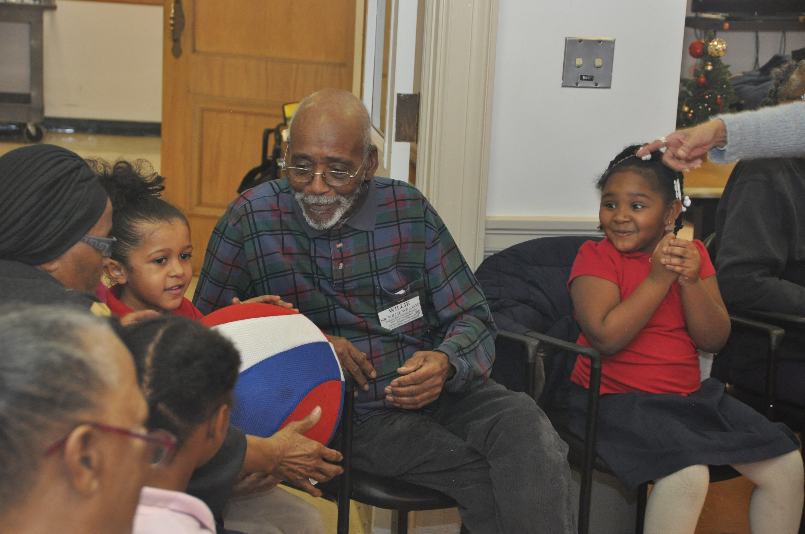 Donate- older adult with a group of children